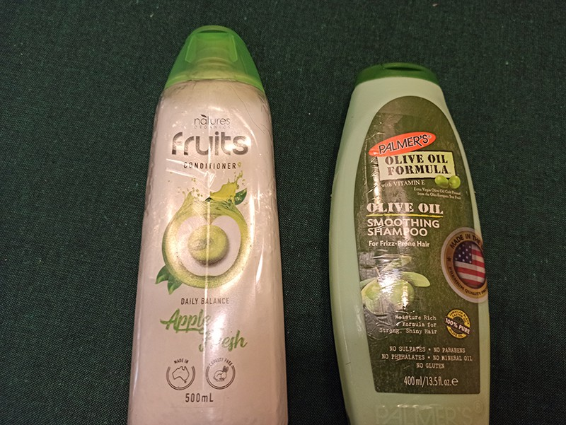 Conditioner bottle with shampoo bottle